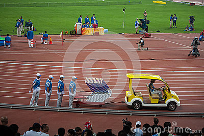 Field crew sets up hurdles for track and field eve Editorial Stock Image