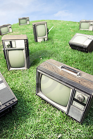Field of grass with retro tv s