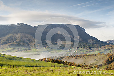 Fields and mountains on a cold morning, fog in the valley