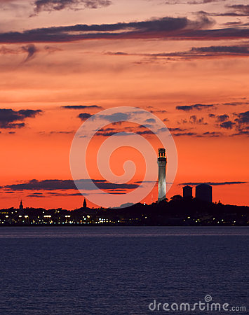 A fiery red sunset frames a Cape Cod Scene