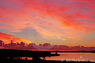 fiery sunset on river with silhouette land, perth
