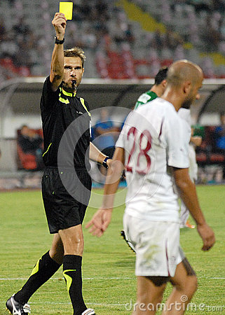 FIFA Referee Alexandru Tudor shows a Yellow card Editorial Stock Image
