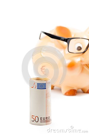 Fifty euro banknote in front of unfocused piggy bank with glasses, concept for business and save money