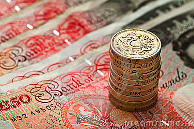 Fifty pounds sterling an coin stack - UK Currency