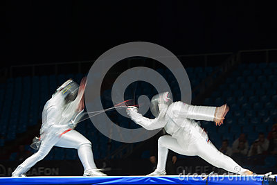 Fight in motion on championship of world in fencing Editorial Stock Photo
