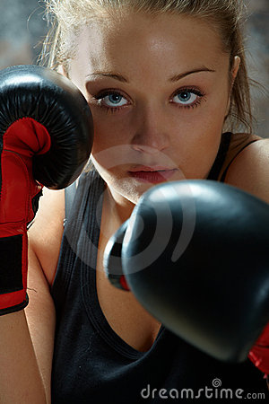 Fighter woman wearing boxing gloves