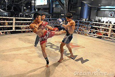 Fighters Compete in a Thai Boxing Match Editorial Stock Photo