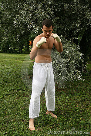 Fighting man practicing his skills outdoor
