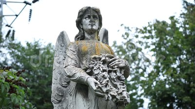 Figure of angel as symbol of sorrow at graveyard stock video footage