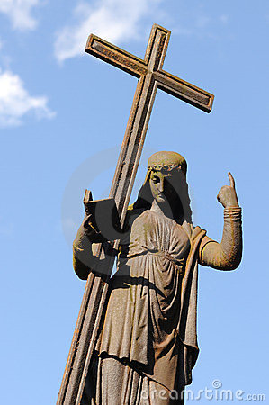 Figure with a cross on blue sky