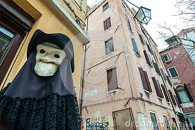 Figure with plague mask and costume in Venice