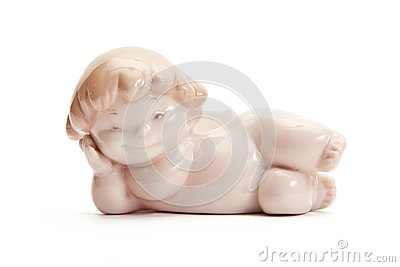 Figurine of angel lying on white background
