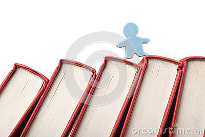 Figurine on the spine of books