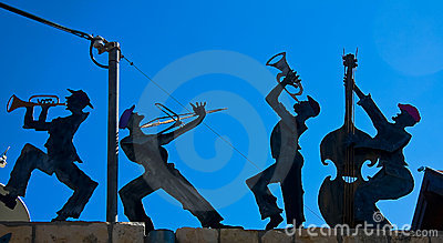 Figurines of a happy band against the skies
