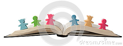 Figurines on open book