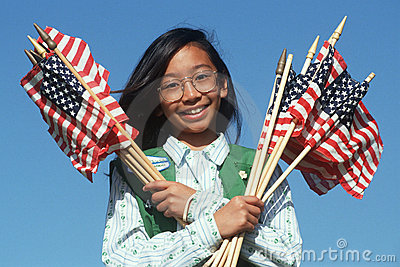 Filipino Girl Scout holding American flags Editorial Photography