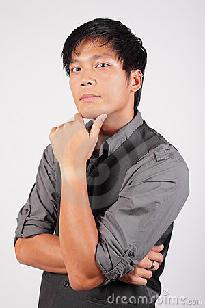 Filipino man with hand on chin