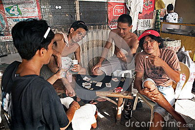 courtesy of thumbs.dreamstime.com love A Whole New World--Love Wins filipino men gambling cards 38153264