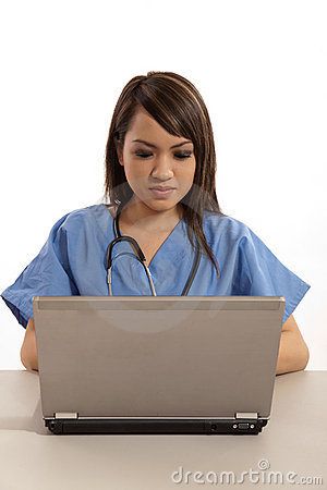 Filipino nurse doctor working on laptop