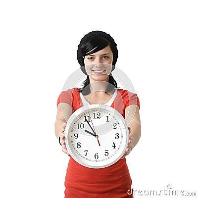 Fille de sourire avec l horloge