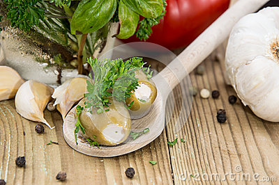 Filled Olives on wooden Spoon