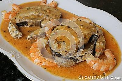 Hake fillets in prawns sauce a fish dish