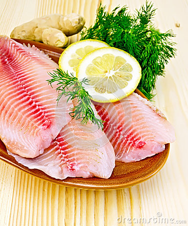 Free Fillets Tilapia In Pottery On The Board Stock Photos - 37796783