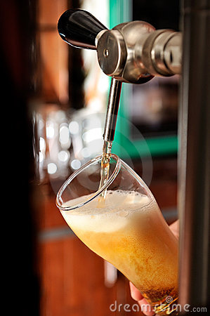 Filling beer glass and tap