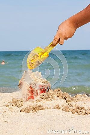 Filling bucket on beach