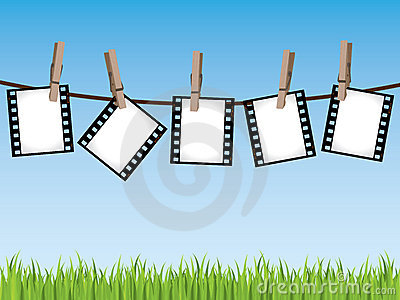 Film strips hanging on a line
