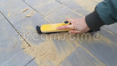 The Final Stage Of Laying Paving Slabs Is The Filling Of Gaps With Dry Sand 20s Stock Video Video Of Filling Landscaping 164442215