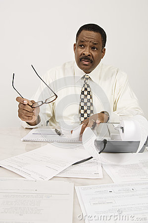Financial Advisor With Expense Receipt In Office