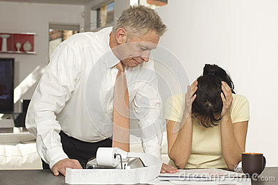 Financial Advisor With Female Client In Office
