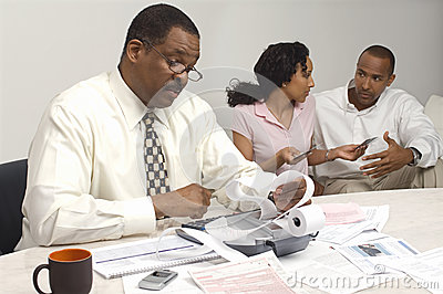 Financial Advisor Holding Expense Receipt With Couple In The Background
