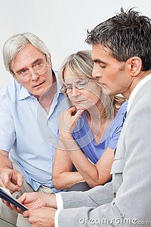 Financial advisor talking to senior