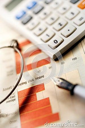 Financial newspaper ,calculator and pen