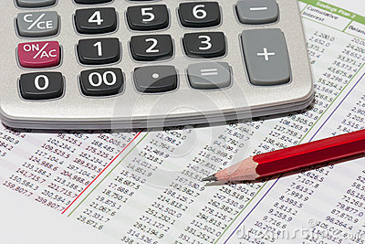 Financial planning with calculator and pencil