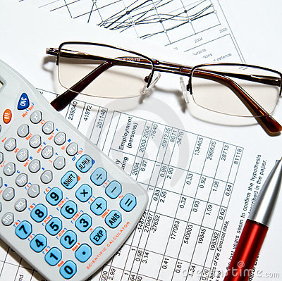 Free Financial Report - Calculator, Glasses And Papers Stock Images - 9204824