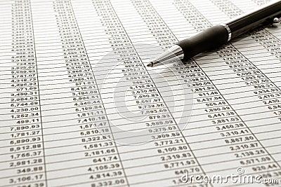 Financial Spreadsheet and Ballpoint Ink Pen