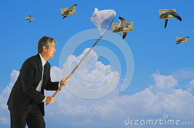 Man netting flying money financial success