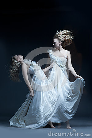 Dancing girl in wedding dress with multiexposition