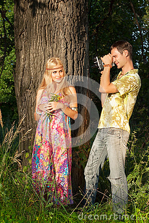 Fine blonde with flowers and young man