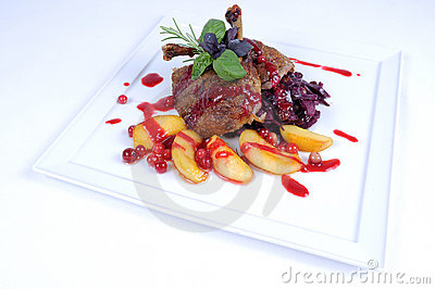 Fine dining meal roast duck with apples