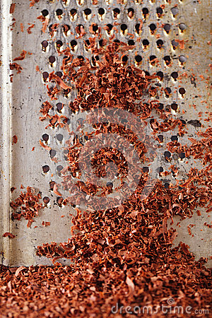 Fine grated dark chocolate on grater