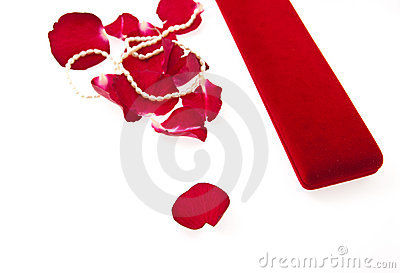 Fine pearl beads and red roses petals