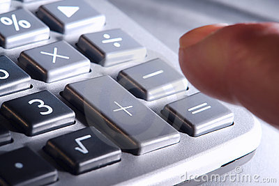 Finger over Calculator Keypad Plus and Equal Signs