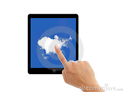 Finger point tablet pc with clouds on screen