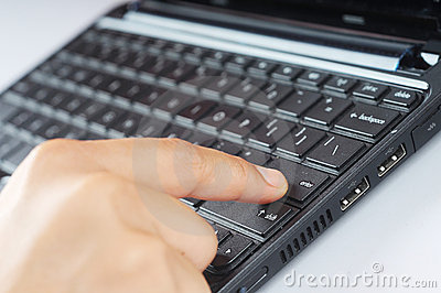 A finger press keyboard enter button