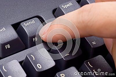 Finger pressing Send button