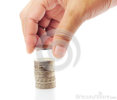 Finger put coin on coin